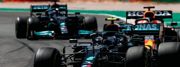 Hamilton ganó en Portugal con una estrategia de medios-duros